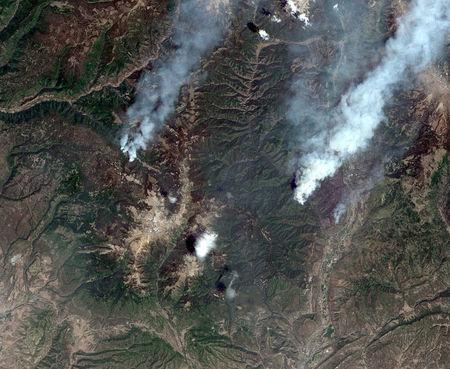 A satellite image shows the Burro Wildfire (L) and the 416 Wildfire burning west of Highway 550 and northwest of Durango, Colorado, U.S., June 9, 2018. Image captured June 9, 2018.   Satellite image ©2018 DigitalGlobe, a Maxar company/Handout via REUTERS