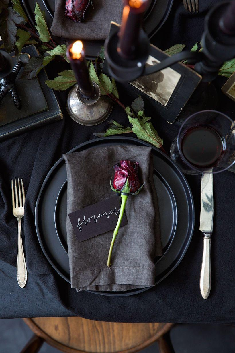 "<p>Host a dinner that even the Addams family would die to attend. An all-black color palette with candlelight and wax-dipped red roses will set the mood.</p><p><strong>Get the tutorial at <a href=""https://camillestyles.com/entertaining/all-black-halloween-table/"" rel=""nofollow noopener"" target=""_blank"" data-ylk=""slk:Camille Styles"" class=""link rapid-noclick-resp"">Camille Styles</a>.</strong></p><p><a class=""link rapid-noclick-resp"" href=""https://www.amazon.com/Monamour-Porcelain-Elegant-Ceramic-Appetizer/dp/B0824PY8Y2/ref=sr_1_5?tag=syn-yahoo-20&ascsubtag=%5Bartid%7C10050.g.4620%5Bsrc%7Cyahoo-us"" rel=""nofollow noopener"" target=""_blank"" data-ylk=""slk:SHOP BLACK DINNER PLATES"">SHOP BLACK DINNER PLATES</a></p>"