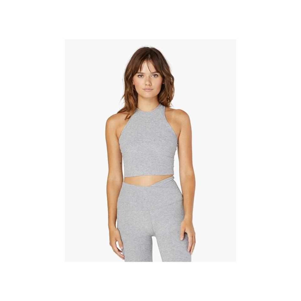 """<p>Tank tops are always a solid go-to for lounging. This more fitted Beyond Yoga Spacedye Studio Cropped Tank option features criss-cross straps in the back and a cropped cut at the waist that makes for a relaxed pairing with your <a href=""""https://www.allure.com/gallery/best-leggings?mbid=synd_yahoo_rss"""" rel=""""nofollow noopener"""" target=""""_blank"""" data-ylk=""""slk:favorite leggings"""" class=""""link rapid-noclick-resp"""">favorite leggings</a>, or get the matching <a href=""""https://beyondyoga.com/products/spacedye-at-your-leisure-high-waisted-midi-legging-silver-mist-sd3463?ref=isp_rel_prd&isp_ref_pos=1"""" rel=""""nofollow noopener"""" target=""""_blank"""" data-ylk=""""slk:Spacedye At Your Leisure High Waisted Midi Legging"""" class=""""link rapid-noclick-resp"""">Spacedye At Your Leisure High Waisted Midi Legging</a> (sold separately). which features a criss-cross waist that comfortably hugs your curves. </p> <p><strong>Sizes available:</strong> XS to XL</p> <p><strong>$68</strong> (<a href=""""https://beyondyoga.com/collections/wfh-essentials/products/spacedye-studio-cropped-tank-silver-mist-sd4383?"""" rel=""""nofollow noopener"""" target=""""_blank"""" data-ylk=""""slk:Shop Now"""" class=""""link rapid-noclick-resp"""">Shop Now</a>)</p>"""