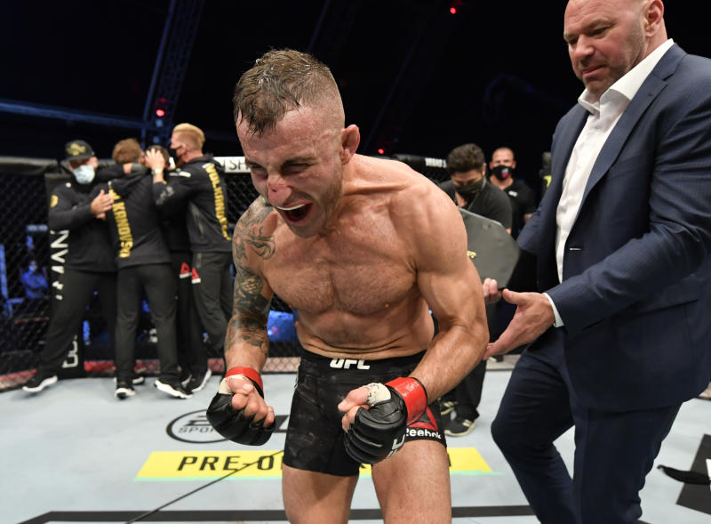 Alexander Volkanovski celebrates after his split-decision victory over Max Holloway in their UFC featherweight championship fight during the UFC 251.