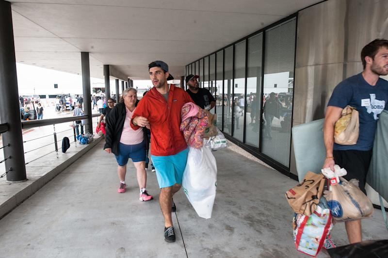 People bring donations to Lakewood Church. (Joseph Rushmore for HuffPost)