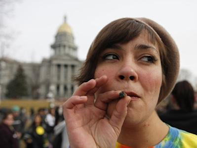 Woman smoking a pot joint in Denver
