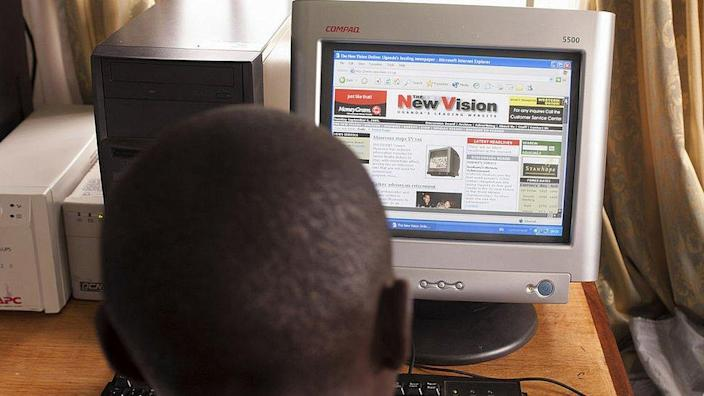 Boy looking at New Vision news website on a PC