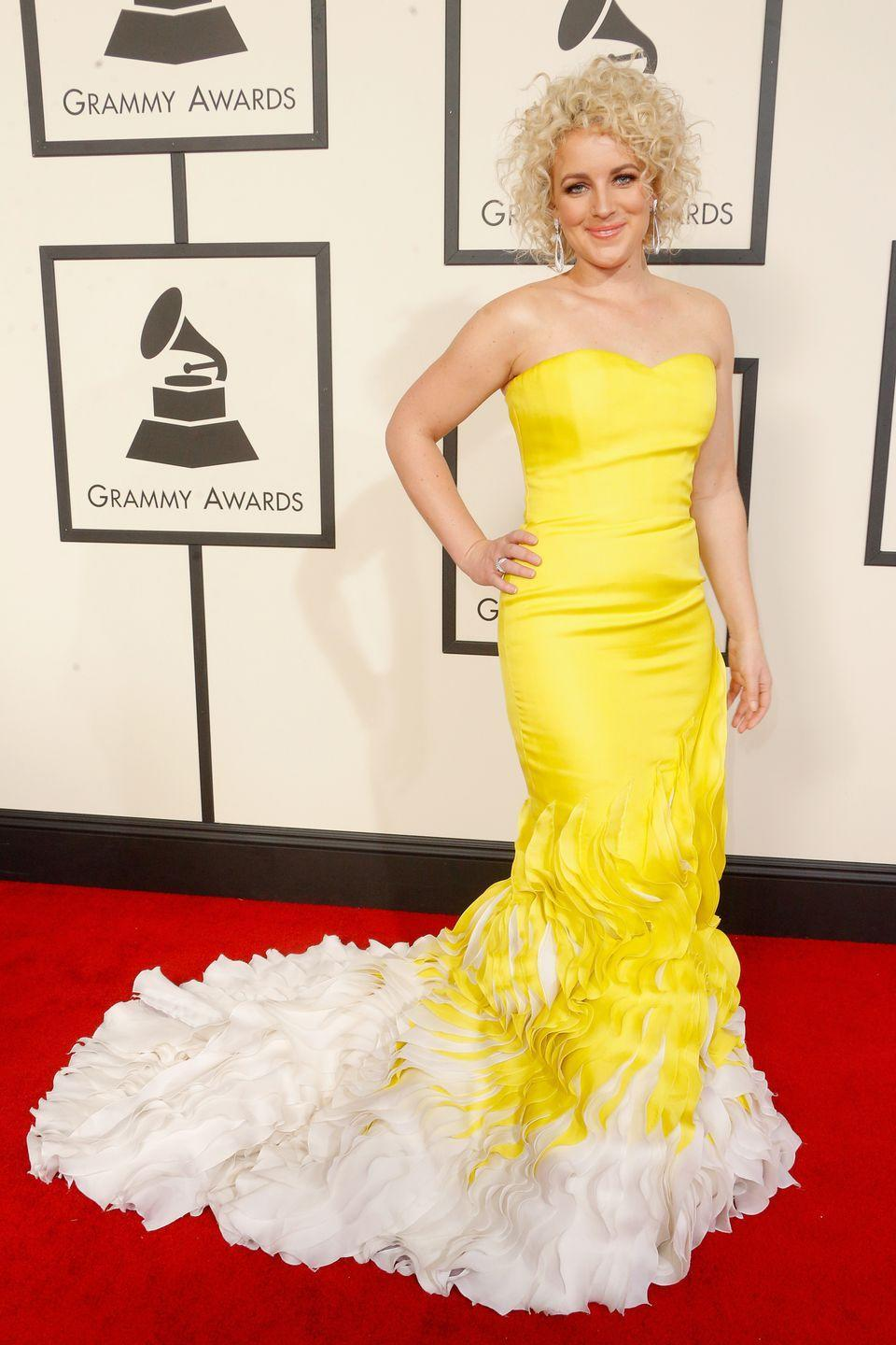 <p>Country singer Cam looked like an ultra-glam version of Belle in a ruffled yellow Georges Chakra gown at the 2016 Grammy Awards.</p>