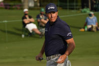 Phil Mickelson walks off the 18th green during the first round of the Masters golf tournament on Thursday, April 8, 2021, in Augusta, Ga. (AP Photo/Matt Slocum)
