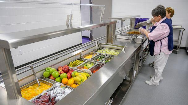 PHOTO: Michelle Hughes, head cook at Harrisburg High School, readies the serving line for lunch at the school on Feb. 14, 2019, in Harrisburg, Ill. (Byron Hetzler/The Southern Illinoisan via AP, FILE)