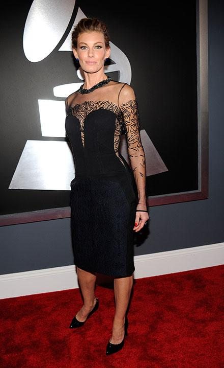 Despite the braces, Faith Hill still looks beautiful, especially in that J. Mendel dress.