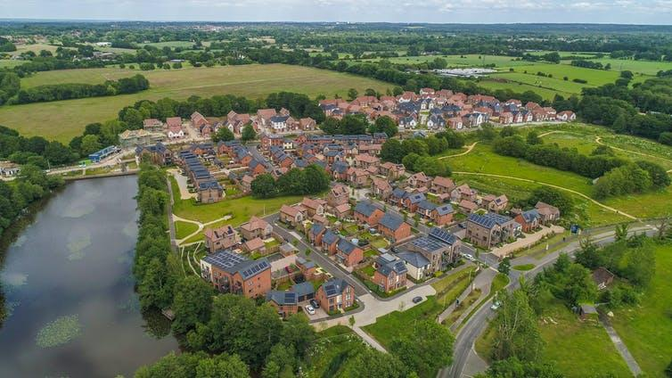 Aerial view of estate of new houses next to river