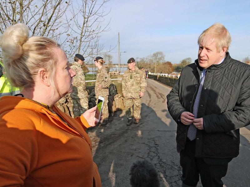 Boris Johnson talks to a woman during a visit to Stainforth, Doncaster: PA