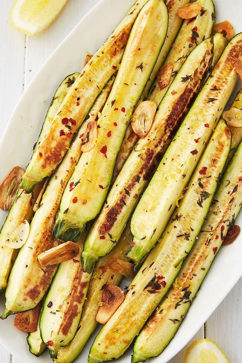 """<p>When it comes to roasted veggies, courgette is one of our favourites. First of all, it's FAST! (No shade, <a href=""""https://www.delish.com/uk/cooking/a28963154/how-to-roast-beetroot/"""" rel=""""nofollow noopener"""" target=""""_blank"""" data-ylk=""""slk:roasted beets"""" class=""""link rapid-noclick-resp"""">roasted beets</a>.) Courgette gets tender in no time at all, so make sure to start checking them early to ensure they're not turning to complete mush.</p><p>Get the <a href=""""https://www.delish.com/uk/cooking/recipes/a33400469/baked-zucchini-recipe/"""" rel=""""nofollow noopener"""" target=""""_blank"""" data-ylk=""""slk:Baked Courgette"""" class=""""link rapid-noclick-resp"""">Baked Courgette</a> recipe.</p>"""