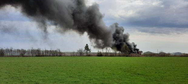 The Alberton fire department says a farm warehouse on DeBlois Road has been completely destroyed by fire. (Submitted by Dena Gaudet - image credit)