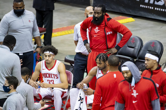 Houston Rockets guard James Harden, top center, joins the huddle during the fourth quarter of a preseason NBA basketball game against the San Antonio Spurs, Thursday, Dec. 17, 2020, in Houston. (Mark Mulligan/Houston Chronicle via AP)