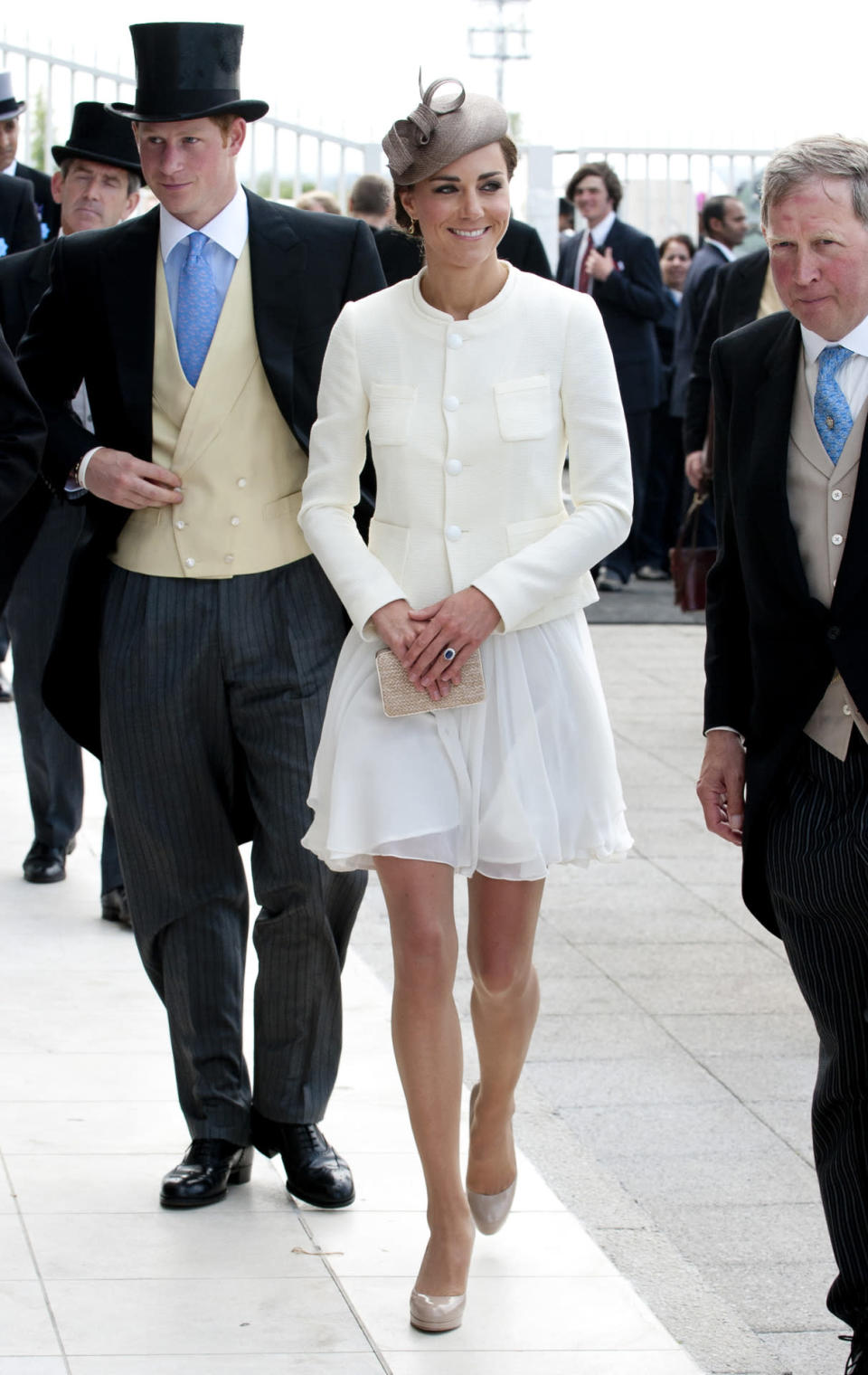 <p>Kate chose a white Reiss look for the Epsom Derby and a white tweed jacket by Joseph. She accessorised with nude heels and clutch by L.K. Bennett.</p><p><i>[Photo: PA]</i></p>