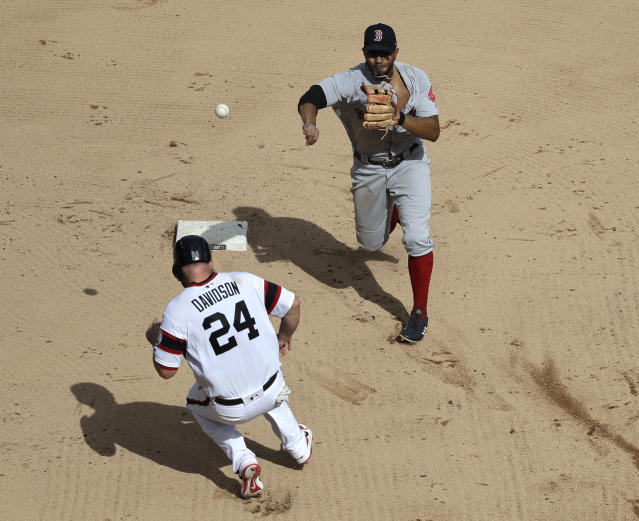 Boston Red Sox shortstop Xander Bogaerts, top, throws to first after forcing out Chicago White Sox's Matt Davidson (24) at second during the sixth inning of a baseball game Sunday, Sept. 2, 2018, in Chicago. Jose Rondon was safe at first. (AP Photo/Nam Y. Huh)