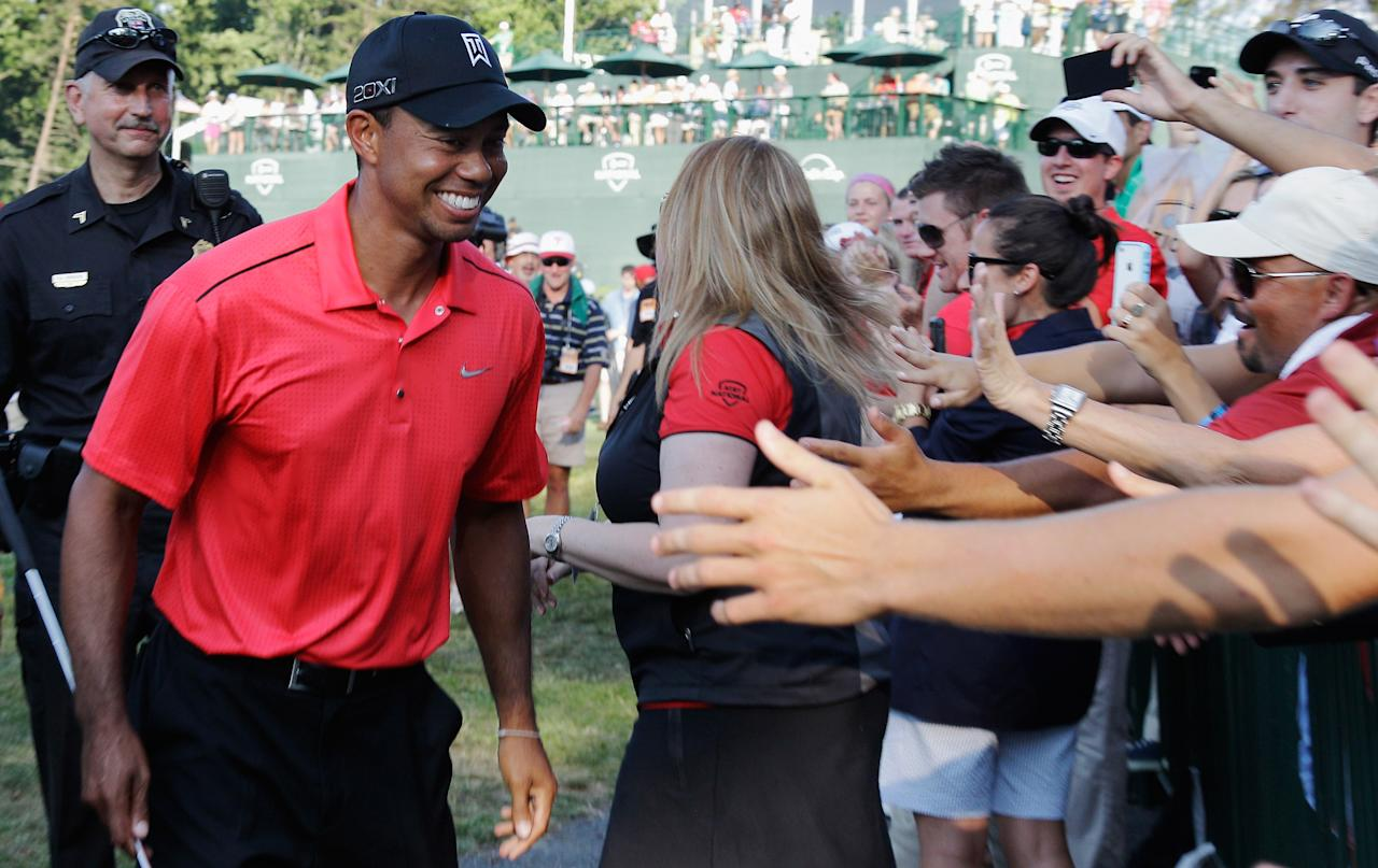BETHESDA, MD - JULY 01:  Tiger Woods is congratulated by fans after winning the AT&T National at Congressional Country Club on July 1, 2012 in Bethesda, Maryland.  (Photo by Rob Carr/Getty Images)