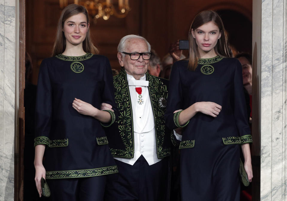 FILE - In this Nov.30, 2016 file photo, French fashion designer Pierre Cardin acknowledges applause after a show to mark 70 years of his creations, in Paris. France's Academy of Fine Arts says Pierre Cardin, the French designer whose Space Age style was among the iconic looks of 20th-century fashion, has died at 98. (AP Photo/Christophe Ena, File)