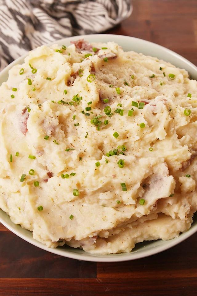 """<p>The creamiest potatoes you'll ever eat.</p><p>Get the recipe from <a href=""""https://www.delish.com/cooking/recipe-ideas/recipes/a56448/crock-pot-garlicky-mashed-potatoes-recipe/"""" target=""""_blank"""">Delish</a>.</p>"""