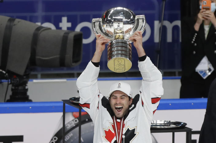 Canada's Adam Henrique holds the trophy after winning the Ice Hockey World Championship final match between Finland and Canada at the Arena in Riga, Latvia, Sunday, June 6, 2021. (AP Photo/Sergei Grits)