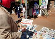 A man browses a newspaper in Sudan's capital Khartoum