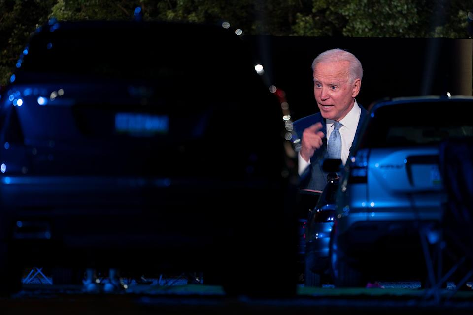 Audience members watch from their cars as Democratic presidential candidate former Vice President Joe Biden, seen on a monitor, speaks during a CNN town hall in Moosic, Pa., Thursday, Sept. 17, 2020.