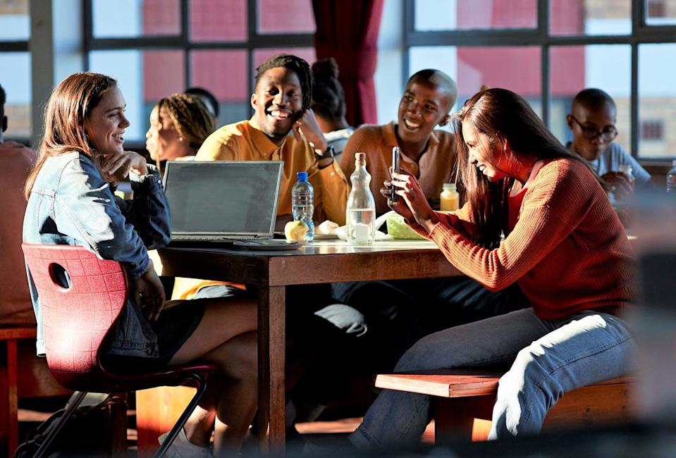 """<span class=""""caption"""">Young people's attitudes toward alcohol have changed over the years. </span> <span class=""""attribution""""><a class=""""link rapid-noclick-resp"""" href=""""https://www.gettyimages.com/detail/photo/cheerful-friends-enjoying-during-lunch-break-royalty-free-image/1170998115"""" rel=""""nofollow noopener"""" target=""""_blank"""" data-ylk=""""slk:Klaus Vedfelt via Getty Images"""">Klaus Vedfelt via Getty Images</a></span>"""