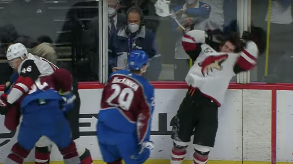 Nathan MacKinnon chucks his helmet at Connor Garland.