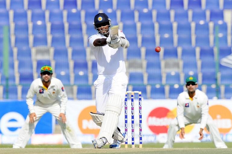 Sri Lankan batsman Angelo Mathews plays a shot during the fourth day of the first cricket Test match between Pakistan and Sri Lanka at the Sheikh Zayed Stadium in Abu Dhabi on January 3, 2014. Pakistan's last six wickets fell cheaply on the third morning of the first Test and restrict them to 383.  Sri Lanka were bowled out for 204 in their first innings of the first Test against Pakistan in Abu Dhabi.  AFP PHOTO/Ishara S. KODIKARA