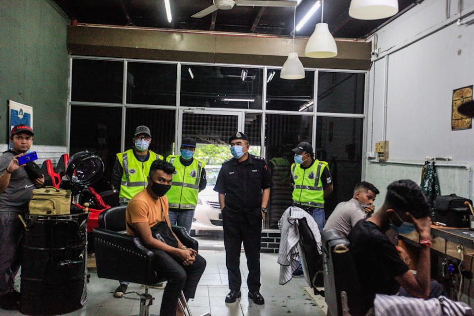 Northern Seberang Perai Police Chief ACP Noorzainy Mohd Noor looks on after their operation caught 13 people gathering in a barber shop here at Butterworth April 27, 2020. — Picture by Sayuti Zainudin