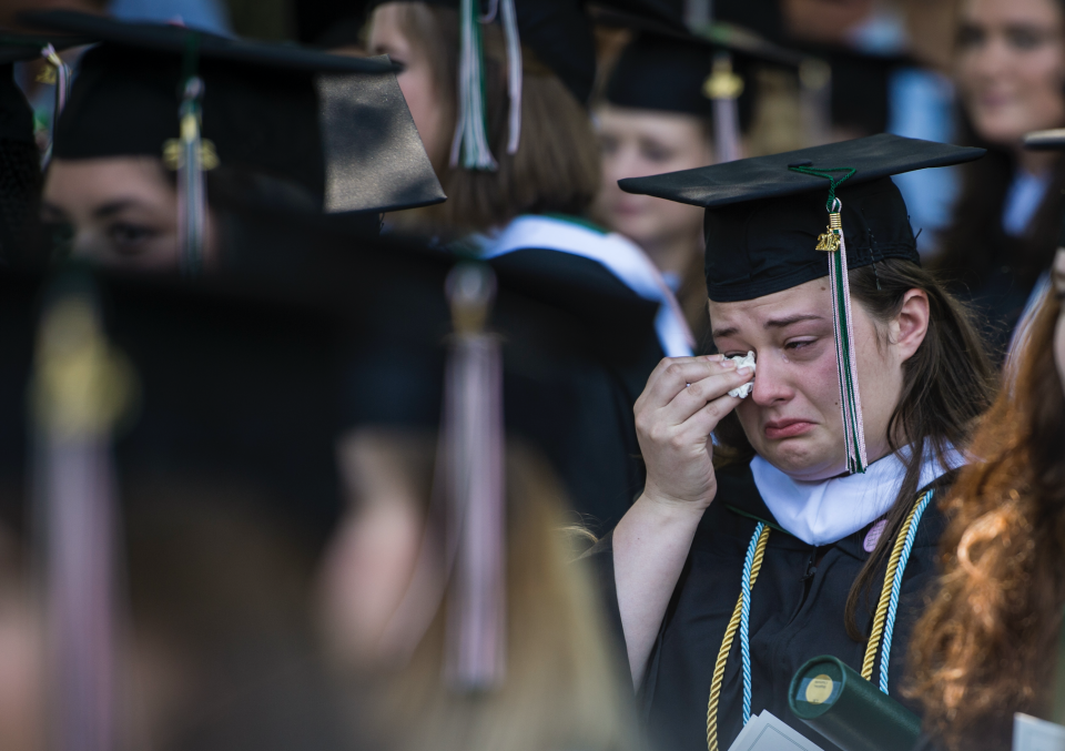 A graduate cries during the final commencement ceremony at Sweet Briar College on May 16, 2015. The school is closing this summer due to funding shortfall. (Photo: Jabin Botsford/The Washington Post via Getty Images)