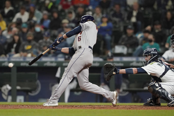 Houston Astros' Jake Meyers hits an RBI-single during the eighth inning of a baseball game against the Seattle Mariners, Monday, Aug. 30, 2021, in Seattle. Kyle Tucker scored on the play. (AP Photo/Ted S. Warren)
