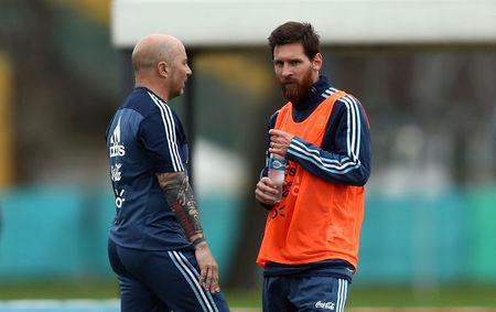FILE PHOTO: Football Soccer - Argentina's national soccer team training - World Cup 2018 Qualifiers - Buenos Aires, Argentina - August 28, 2017 - Argentina's head coach Jorge Sampaoli talks to Lionel Messi during a training session ahead of the match against Uruguay. REUTERS/Marcos Brindicci/File Photo