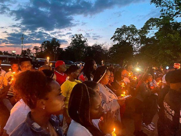 PHOTO: People gather near Interstate 75 and McNichols in Detroit, June 19, 2021, for a vigil to memorialize Brison Christian, the two-year-old boy who was shot near that location.  (Amelia Benavides-Colon/AP)