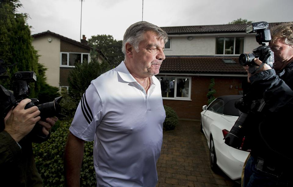 Sam Allardyce is swarmed by reporters as he leaves his family home in Bolton following his resignation as England manager. (Getty)