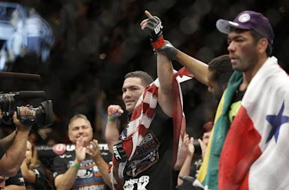 Chris Weidman celebrates after defeating Lyoto Machida at UFC 175 Saturday. (AP Photo/John Locher)