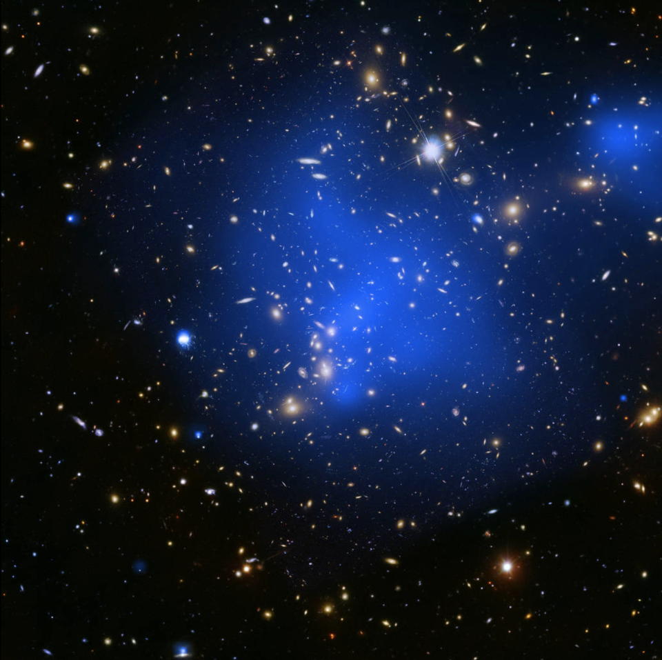 """<p><a href=""""https://www.popularmechanics.com/space/deep-space/a26356/nasa-gigantic-hot-gas-wave/"""" rel=""""nofollow noopener"""" target=""""_blank"""" data-ylk=""""slk:Blistering hot galaxy clusters"""" class=""""link rapid-noclick-resp"""">Blistering hot galaxy clusters</a> like Abell 2744, shown here in blue, are some of the largest objects in the universe, according to <a href=""""https://www.nasa.gov/mission_pages/chandra/news/nasas-chandra-opens-treasure-trove-of-cosmic-delights.html"""" rel=""""nofollow noopener"""" target=""""_blank"""" data-ylk=""""slk:NASA"""" class=""""link rapid-noclick-resp"""">NASA</a>. </p>"""