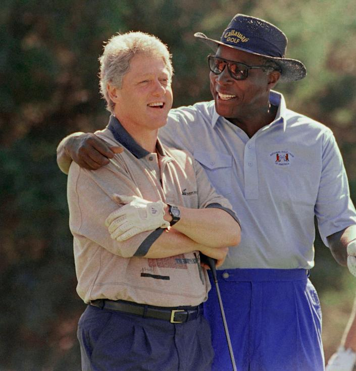 Vernon Jordan, photographed with President Bill Clinton on the golf course in Martha's Vineyard in August 1993, was a trusted adviser to the president.