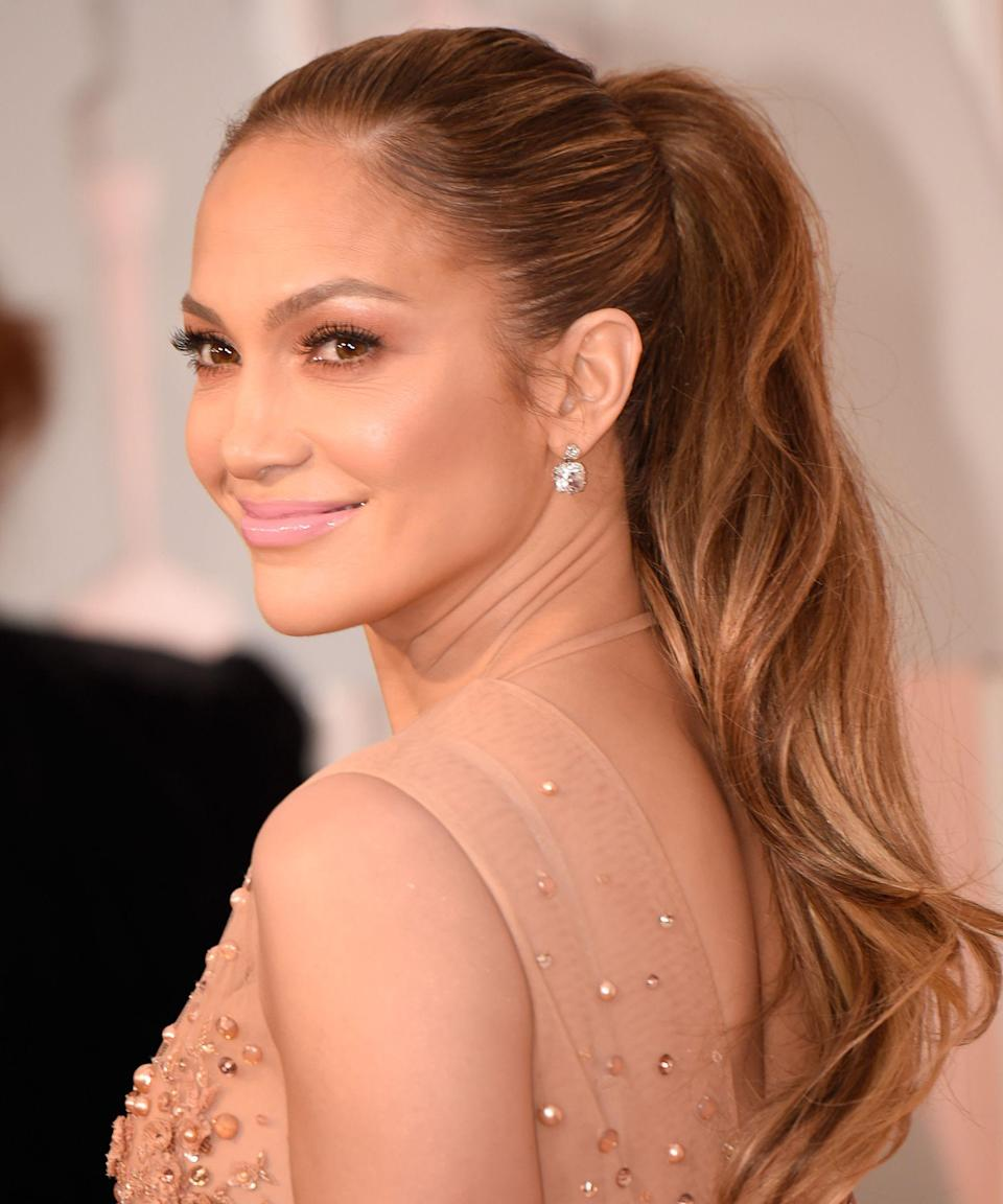 """<p><strong>Jennifer Lopez, 2015</strong></p><p>If there's one hair look J. Lo does well, it's the grown-up pony. Her trademark style is always perfectly-coiffed: pulled back tight and cascading straight down to the center of her back.</p><span class=""""copyright"""">Photo: Kevin Mazur/Getty Images.</span>"""