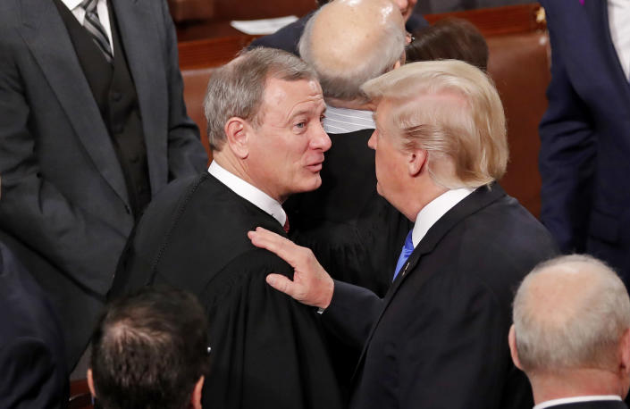 U.S. President Trump greets Justice Roberts after delivering his State of the Union address in Washington (Jonathan Ernst / Reuters file)