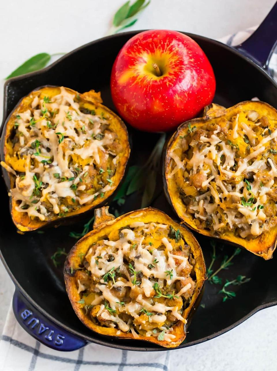 "<p>Stuffed with Italian sausage, apples, mushrooms, and spices, this acorn squash side dish will be the hit of dinner.</p> <p><strong>Get the recipe:</strong> <a href=""http://www.wellplated.com/sausage-stuffed-acorn-squash/"" class=""link rapid-noclick-resp"" rel=""nofollow noopener"" target=""_blank"" data-ylk=""slk:sausage stuffed acorn squash"">sausage stuffed acorn squash</a></p>"