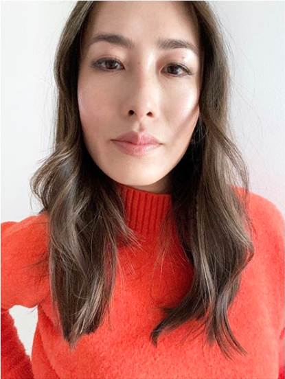 Melissa Leong wearing an orange jumper
