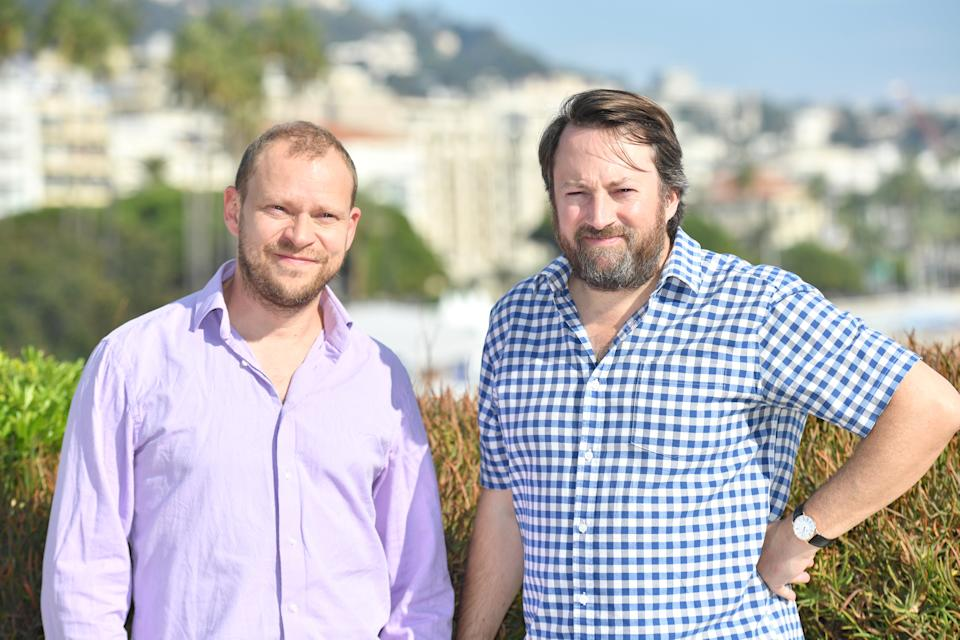 (LtR) actors David Mitchell and Robert Webb pose during the MIPCOM trade show (standing for International Market of Communications Programmes) in Cannes, southern France, on October 17, 2017.  / AFP PHOTO / YANN COATSALIOU        (Photo credit should read YANN COATSALIOU/AFP via Getty Images)
