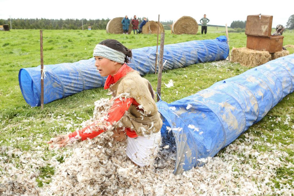 """Like James Bond Again"" -- In this Road Block, Winnie must participate in a Shemozzle Race which requires one team member to dress as a Kiwi sheperd and run through a wild obstacle course while collecting eggs. Once they deliver all their unbroken eggs to the finish like, they will receive the next clue, on ""The Amazing Race."""