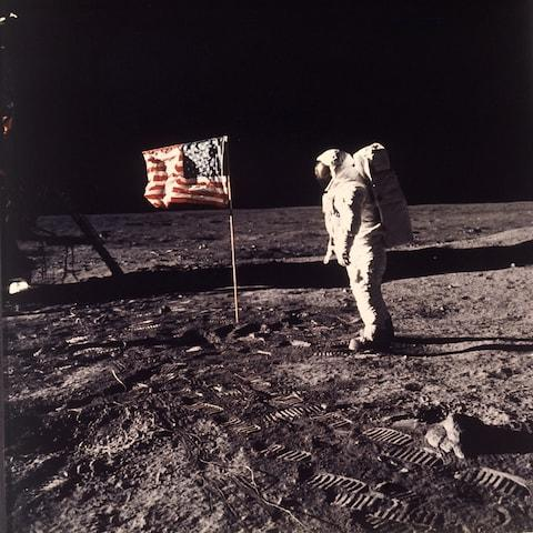 Buzz Aldrin Jr. beside the U.S. flag after man reaches the Moon for the first time during the Apollo 11 mission on July 20, 1969. - Credit: AP