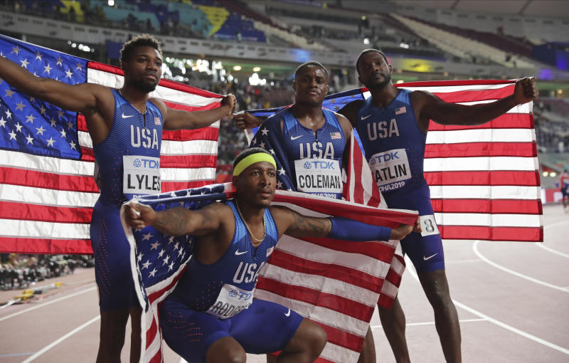 Gold medalists in the 4x100 relay from left, Noah Lyles, Michael Rodgers, Christian Coleman and Justin Gatlin, of the United States, celebrate at the World Athletics Championships in Doha, Qatar, Saturday, Oct. 5, 2019.(AP Photo/Hassan Ammar)