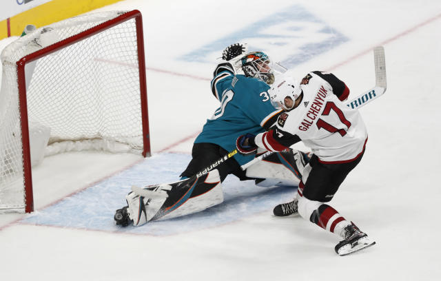 Arizona Coyotes' Alex Galchenyuk (17) scores the game-winning goal during a shootout in an NHL hockey game against San Jose Sharks goaltender Aaron Dell (30) in San Jose, Calif., Sunday, Dec. 23, 2018. (AP Photo/Josie Lepe)