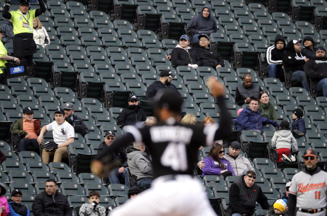 Baseball fans watch the first game of a baseball doubleheader between the Baltimore Orioles and the Chicago White Sox in Chicago, Wednesday, May 1, 2019. (AP Photo/Nam Y. Huh)