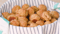 """<p><strong>Recipe: <a href=""""https://www.southernliving.com/recipes/sausage-ball-recipe"""" rel=""""nofollow noopener"""" target=""""_blank"""" data-ylk=""""slk:Sausage Balls"""" class=""""link rapid-noclick-resp"""">Sausage Balls</a></strong></p> <p>No matter the time of day, sausage balls are a bite-sized snack that will be welcome at any party. </p>"""