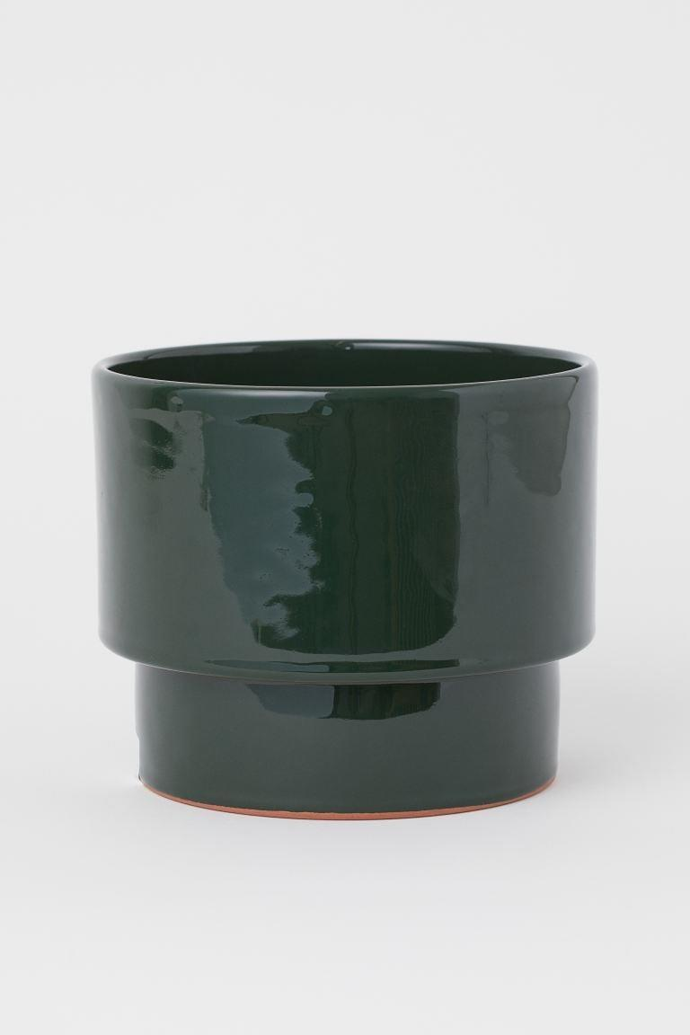 "<p>This pretty <a href=""https://www.popsugar.com/buy/HampM-Ceramic-Plant-Pot-584975?p_name=H%26amp%3BM%20Ceramic%20Plant%20Pot&retailer=www2.hm.com&pid=584975&price=18&evar1=casa%3Aus&evar9=45784601&evar98=https%3A%2F%2Fwww.popsugar.com%2Fhome%2Fphoto-gallery%2F45784601%2Fimage%2F47575740%2FHM-Ceramic-Plant-Pot&list1=shopping%2Cproducts%20under%20%2450%2Cdecor%20inspiration%2Caffordable%20shopping%2Chome%20shopping&prop13=api&pdata=1"" class=""link rapid-noclick-resp"" rel=""nofollow noopener"" target=""_blank"" data-ylk=""slk:H&amp;M Ceramic Plant Pot"">H&amp;M Ceramic Plant Pot</a> ($18) also comes in white.</p>"