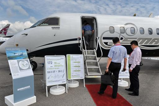 <p>A Bombardier Q400 NexGen plane on displayed at the Singapore Airshow on February 13, 2014</p>