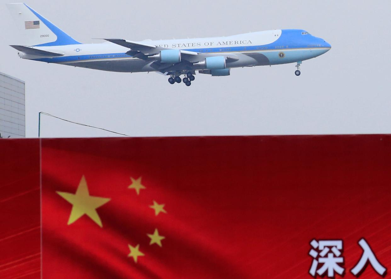 U.S. President Donald Trump and first lady Melania arrive on Air Force One in Beijing, China, November 8, 2017. REUTERS/Aly Song